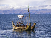 Totora boat in lake Titicaca. Totora reed boat in Lake Titicaca between Peru and Bolivia Royalty Free Stock Photography