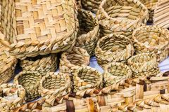 Totora crafts. Such as baskets, fans, animals and mats, handmade by artisans from Imbabura, Ecuador royalty free stock images