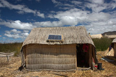 Totora reed house. Traditional house made out of totora reed, floating island of Uros on lake titicaca in Peru Royalty Free Stock Image