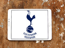 Tottenham hotspur soccer club logo. Logo of english soccer club Tottenham hotspur on samsung tablet on wooden background Stock Images