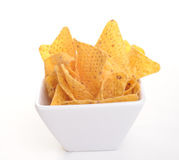 Tottilla chips in a bowl. Photograph of tortilla chips in a bowl, shot in studio against a white background Stock Photo