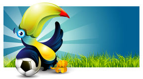 Toucan. Bird sitting on the grass and rests on a soccer ball stock illustration