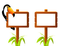 toucan bird sitting on a blank wooden sign board Stock Photos