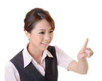 Touch. Young Asian business woman point and touch by finger, closeup portrait and focus on finger against white background Stock Image