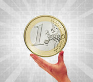 Touch the coin Royalty Free Stock Images
