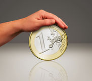 Touch the coin Stock Photos