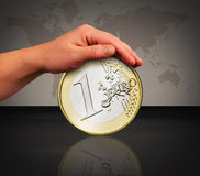 Touch the coin Stock Image