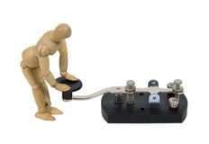 In touch with communication. Shown by model with antique telegraph key used for Morse Code - path included Royalty Free Stock Images