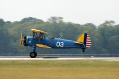 Touch Down. Antique biplane landing at the Fauquier County,Virginia Airport stock photos