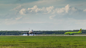 Touch down Airbus A320 Ural Airlines Stock Image