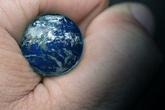 Touch Earth with finger,Elements of this image furnished by NASA royalty free stock photos