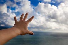 touch för luftoklarhetshand Arkivbild