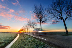 A Touch of Frost. Traffic rushes over the rural country roads at sunset Stock Image
