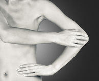Touch hands. Woman's hands form a triangle. Naked body of a woman on a gray background Stock Photography