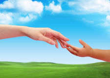 The Touch Of Hands Between Old And Young 2 royalty free stock images