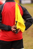 Touch judge. An assistant referee/touch judge in rugby with a yellow flag Stock Image