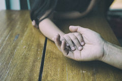 Touch of Love. A hand of girl touch on a palm of her father. bon. Daughter& x27;s hand touch on a father& x27;s hand -  love, bonding and family concept Royalty Free Stock Photo