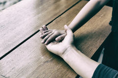 Touch of Love. A hand of girl touch on a palm of her father. bon. Daughter& x27;s hand touch on a father& x27;s hand -  love, bonding and family concept Royalty Free Stock Image