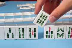 Touch a mahjong tiles Stock Image