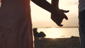 A touch of male and female hands against the sunset. Love, romance, relationships.  stock video