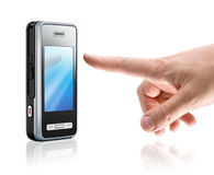 Touch mobile phone. Touch screen mobile phone and human finger, isolated on white Stock Photography