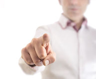 Touch nothing on white. A man touching an invisible interface with his finger. Place you own graphics royalty free stock image