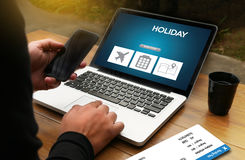 Touch Online holiday reservation booking interface to go trip HO Royalty Free Stock Photography