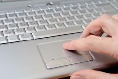 Touch pad. A businessman using the touch pad on the laptop Stock Images