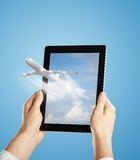 Touch pad with airplane Royalty Free Stock Images