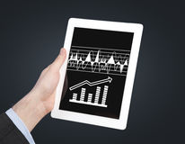 Touch pad with charts Royalty Free Stock Images