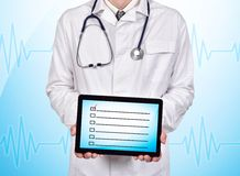 Touch pad with checklist Stock Photography