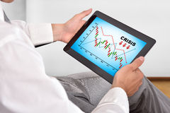 Touch pad with crisis chart Stock Photo