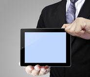 Touch-pad in hands Stock Image