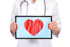 Touch pad with heart Royalty Free Stock Photo