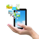 Touch pad and images. Touch pad PC and streaming images virtual buttons on women hand Stock Photography