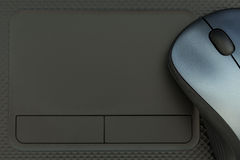 Touch pad and mouse. Laptop can control by both mouse and touchpad. Empty space of the touchpad in this picture can fill any word in it Stock Photos