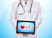 Touch pad with pulse. Doctor holding touch pad with pulse on a blue background Stock Images