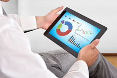 Touch pad with stock chart Stock Photo