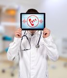 Touch pad with 911 symbol. Doctor holding touch pad with 911 symbol Royalty Free Stock Photo