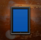 Touch pad. On a wooden background Stock Images