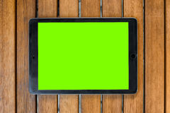 Touch pad on a wooden background Royalty Free Stock Image