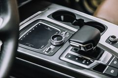 Touch panel in a premium car. Management of multimedia functions, and options of the car, navigation, music. Cup holders and gear. Lever royalty free stock photos