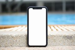 Touch phone with isolated screen on background of pool Royalty Free Stock Photo