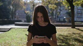 Touch phone sms writing, young woman girl stock photography