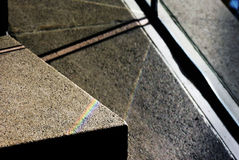 Touch of Rainbow. A photo of a rainbow on concrete in a galleria Stock Images