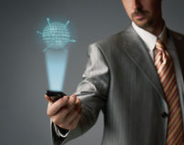 Touch screen cell phone. Businessman with touch screen mobile phone Royalty Free Stock Photo