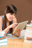 Touch screen computer - woman teenager study Stock Photo