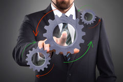 Touch Screen Concept. Businessman Activate Gears, touch Screen Concept Royalty Free Stock Photo
