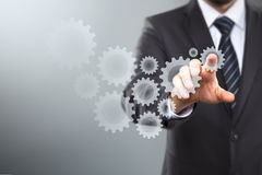 Touch Screen Concept. Businessman Activate Gears, touch Screen Concept Stock Image