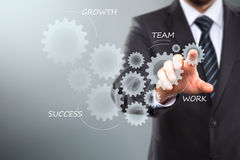 Touch Screen Concept. Businessman Activate Gears, touch Screen Concept Royalty Free Stock Images